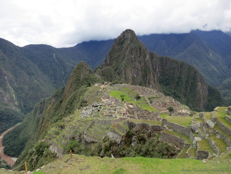 "A view of the city's ruins on Machu Picchu and Wayna Picchu (""young peak"") in the background. I'm sure the view from Wayna Picchu would have been even more incredible; unfortunately, we didn't buy the tickets needed to ascend beforehand."